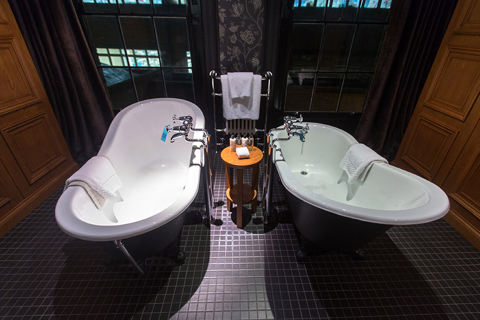Matching cast iron baths in the Hotel du Vin Cambridge's Wolfbass Suite